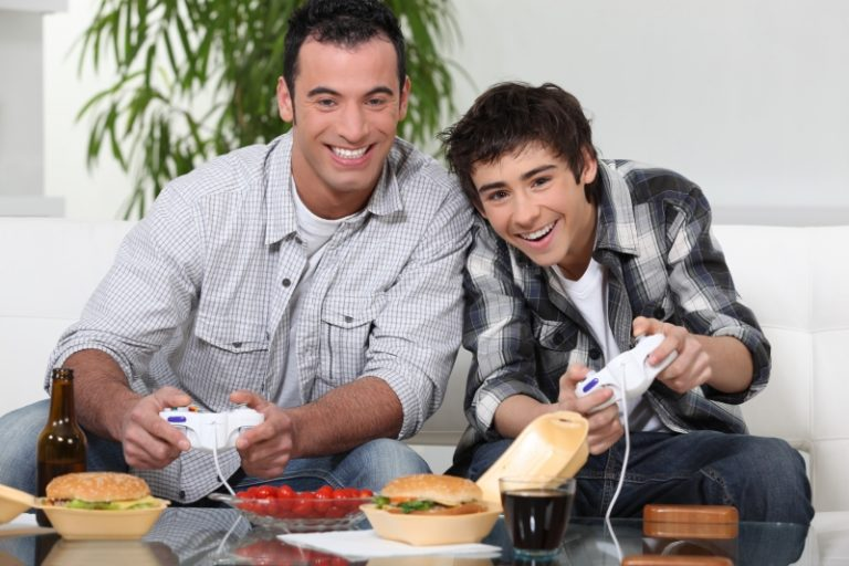 2843470-father-and-son-playing-video-game